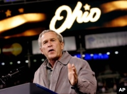 FILE - President George W. Bush speaks at a campaign rally at the Great American Ball Park in Cincinnati.