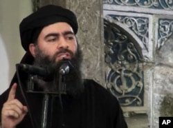 FILE - This image taken from a militant website July 5, 2014, purports to show the leader of the Islamic State group, Abu Bakr al-Baghdadi, who released a message encouraging his followers to keep up the fight for the city of Mosul.