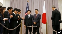Japanese Prime Minister Shinzo Abe, right center, speaks to members of the press after meeting with President-elect Donald Trump in New York, Nov. 17, 2016.