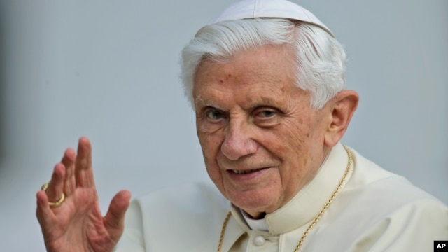 Pope Benedict XVI delivers his blessing as he arrives for a weekly general audience in St. Peter's Square at the Vatican, Oct. 3, 2012.
