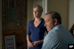 "FILE - This image released by Netflix shows Robin Wright as Claire Underwood, left, and Kevin Spacey as Francis Underwood in a scene from ""House of Cards."""