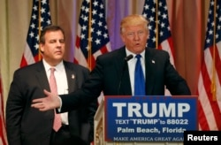 FILE - Republican U.S. presidential candidate Donald Trump, with former rival candidate Governor Chris Christie, left, at his side, speaks at a news conference in Palm Beach, Fla., March 1, 2016.
