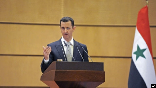 Syria's President Bashar al-Assad speaks at Damascus University in Syria, January 10, 2012.