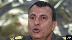 General Ismail Etman, director of moral affairs and a member of the Supreme Council of the Armed Forces, speaks during a news conference at the military media centre in Cairo, March 28, 2011