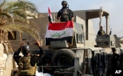 Các lực lượng an inh Iraq tại khu công ốc chính phủ vừa tái chiếm được từ tay Nhà nước Hồi giáo hôm 28/12/2015.