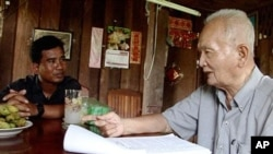 Thet Sambath, a journalist, with former Khmer Rouge leader Nuon Chea, file photo.