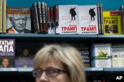 Books by and about Donald Trump, U.S. president-elect at the time, are on display in the Moscow House of Books store in Moscow, Russia, Nov. 14, 2016. Trump's books and literature about him have been at high demand at Moscow book stores following his victory in the U.S. presidential elections, according to the bookstore.