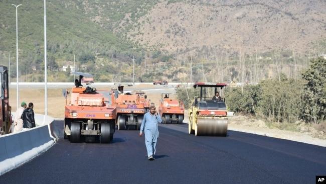 FILE - Work in progress at the site of Pakistan China Silk Road in Haripur, Pakistan, Dec. 22, 2017.