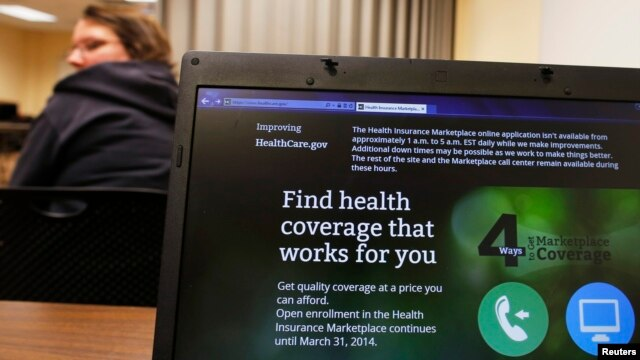 Liz Carlson, a self-employed student, attends a health care enrollment fair co-sponsored by Planned Parenthood of Northern New England and the State Employees Association at Great Bay Community College in Portsmouth, New Hampshire, Nov. 9, 2013.