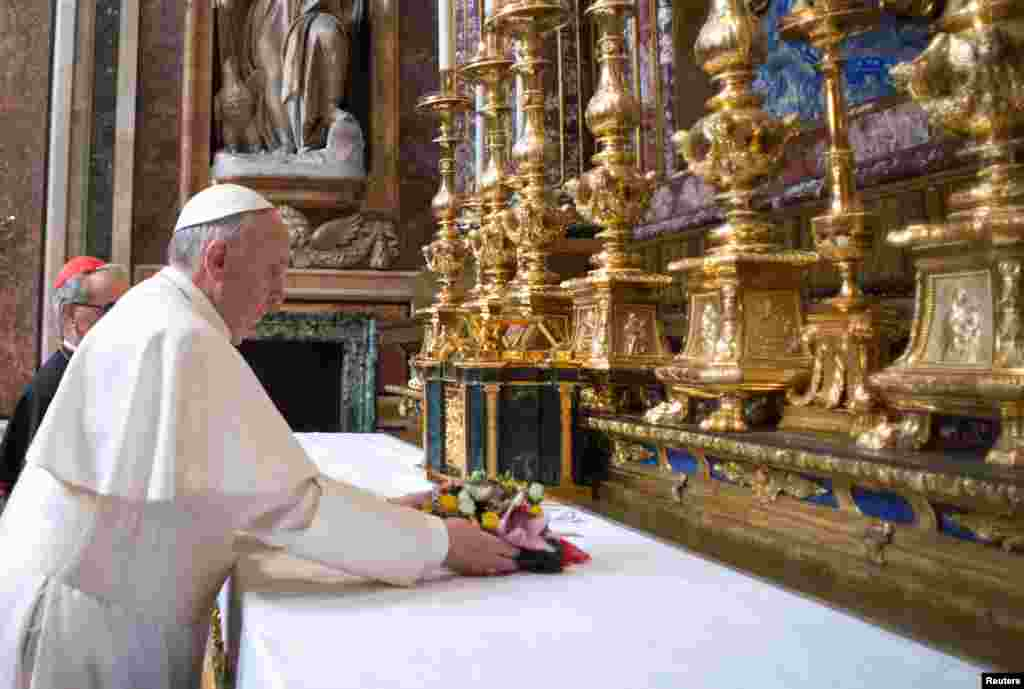 Newly elected Pope Francis makes a private visit to the 5th-century Basilica of Santa Maria Maggiore, in a photo released by Osservatore Romano in Rome, March 14, 2013.