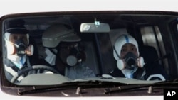 Policemen wear gas masks and patrol near the nuclear power plant in Fukushima prefecture on March 12, 2011 a day after a massive 8.9 magnitude quake and tsunami hit the region.