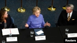"""Democratic U.S. presidential candidate Hillary Clinton (C) speaks during a campaign event in Hampton, Virginia, June 15, 2016. Clinton blasted Trump at the event, saying that """"A ban on Muslims would not have stopped [the Orlando] attack."""""""