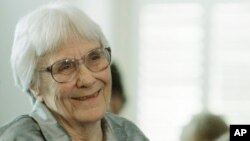FILE - Author Harper Lee smiles during a ceremony at the state capitol in Montgomery, Alabama, Aug. 20, 2007.