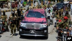 A vehicle carrying Syed Salahuddin, the top leader of the Hizbul Mujahideen, is escorted by his supporters, arrives for a press conference in Muzaffarabad, the capital of Pakistani controlled Kashmir, Saturday, July 1, 2017.