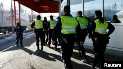 Swiss customs officers arrive at the Swiss-French customs post of Bardonnex near Geneva, Switzerland, Dec. 11, 2015.