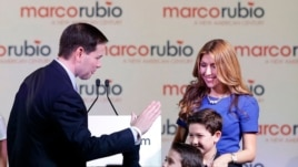 After announcing his 2016 presidential bid, Senator Marco Rubio of Florida high fives son Dominic as wife Jeanette and son Anthony watch in Miami, April 13, 2015.