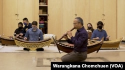Priwan Nanongkhan teaches a group of American students in a Thai ensemble at Kent State University, OH.