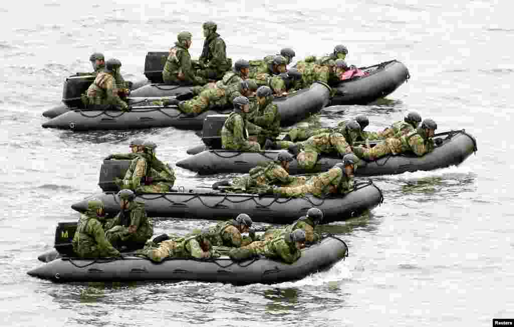Japan Self-Defense Force (JSDF) soldiers ride rubber boats near Eniyabanare Island during a military drill, off Setouchi town on the southern Japanese island of Amami Oshima, Kagoshima prefecture, in this photo taken by Kyodo.