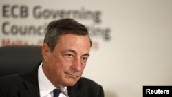 FILE - European Central Bank (ECB) president Mario Draghi addresses a news conference after a meeting of the ECB Governing Council in St Julian's, outside Valletta, Malta, Oct. 22, 2015.