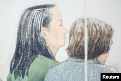 FILE - Huawei CFO Meng Wanzhou, left, who was arrested on an extradition warrant, appears at her B.C. Supreme Court bail hearing in a drawing in Vancouver, British Columbia, Canada, Dec. 10, 2018.