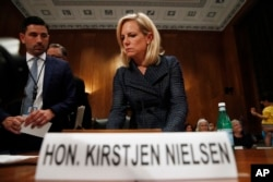 """Homeland Security Secretary Kirstjen Nielsen arrives to testify to the Senate Homeland Security Committee, May 15, 2018, on Capitol Hill in Washington. Nielsen told the committee that DHS needed """"clear legal authority to identify, track and mitigate drone"""
