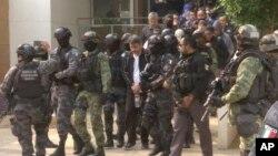 Polisi Meksiko dalam operasi penangkapan terhadap pemimpin kartel narkoba (foto: ilustrasi).
