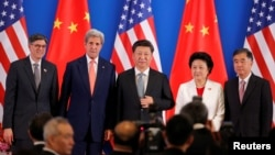 L-R, U.S. Treasury Secretary Jack Lew, U.S. Secretary of State John Kerry, China's President Xi Jinping, China's Vice Premiers Liu Yandong and Wang Yang, and State Councilor Yang Jiechi pose for photo during the joint opening ceremony of the 8th round of U.S.-China Strategic and Economic Dialogues and the 7th round of U.S.-China High-Level Consultation on People-to-People Exchange in Beijing June 6, 2016.