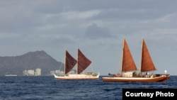 The Hokulea (left) and the Hikianalia sailing off the Hawaiian Islands (date unknown). (Oiwi TV and the Polynesian Voyaging Society)