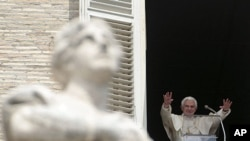 Pope Benedict XVI acknowledges the crowd during a prayer from his studio window overlooking St. Peter's Square at the Vatican, Sunday, May 15, 2011