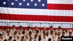 FILE - U.S. Marines pray before the arrival of President Barack Obama at Marine Corps Base-Camp Pendleton in California, August 7, 2013.