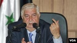 Menlu Suriah Walid Moallem mengecam sanksi-sanksi Uni Eropa dalam konferensi pers di Damaskus (22/6).