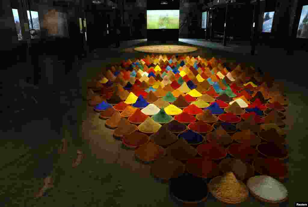"A visitor walks past an installation called ""Campo de Color"" by Bolivian artist Sonia Falcone, May 28, 2013."