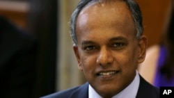 FILE - Singapore's Minister for Foreign Affairs and Law K. Shanmugam poses for photographs before a dinner with U. S. Secretary of State Hillary Rodham Clinton at the Ministry of Foreign Affairs, Nov. 16, 2012.