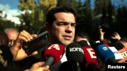 Alexis Tsipras, opposition leader and head of radical leftist Syriza party, talks to reporters outside the parliament building after the last round of a presidential vote in Athens, December 29, 2014.