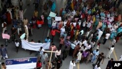 Pakistani Christians block a main highway during a rally to condemn a suicide bombing on a church, in Islamabad, Pakistan, Sept. 23, 2013.
