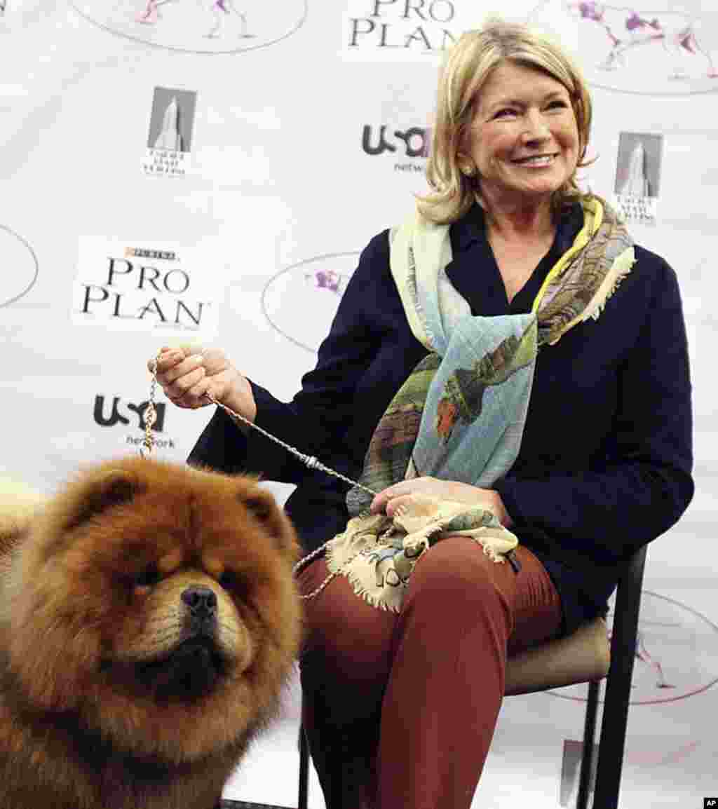 Martha Stewart sits her with her dog Genghis Khan , a Chow Chow breed, before competing in the Best of Group category at the 136th Westminster Kennel Club Dog Show in New York, February 13, 2012. (REUTERS)