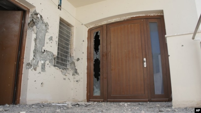 The front door of Mohammed Gadhafi's Tripoli house damaged during his brief capture.