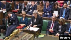An image from video shows Britain's Prime Minister Theresa May speaking about Brexit in the House of Commons, in central London, Britain, Nov. 15, 2018.