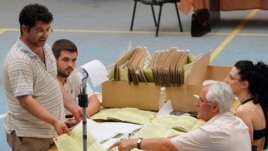 Albanian election officials count votes in Tirana, June 24, 2013.