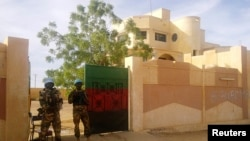 FILE - MINUSMA peacekeepers stand guard in front of the governor's office in Kidal, Mali.