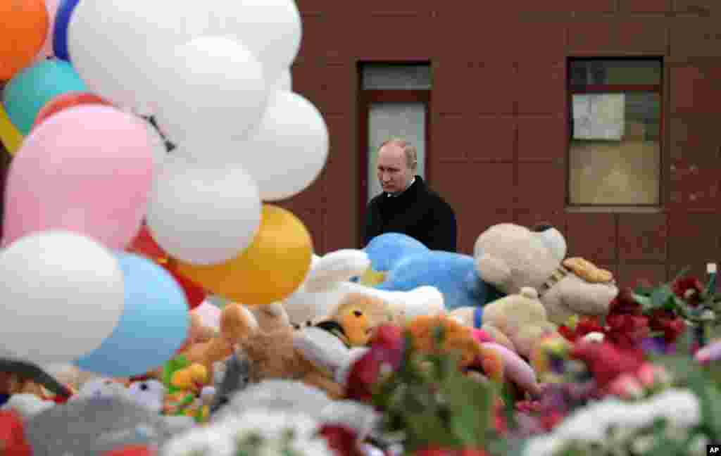 Russian President Vladimir Putin lays flowers at a memorial for the victims of a fire in a multi-story shopping center in the Siberian city of Kemerovo, about 3,000 kilometers (1,900 miles) east of Moscow, Russia.