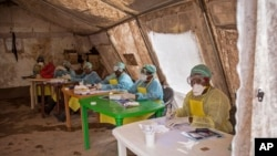 Health workers await patients to screen for the deadly Ebola virus at the Kenema Government Hospital in Sierra Leone.