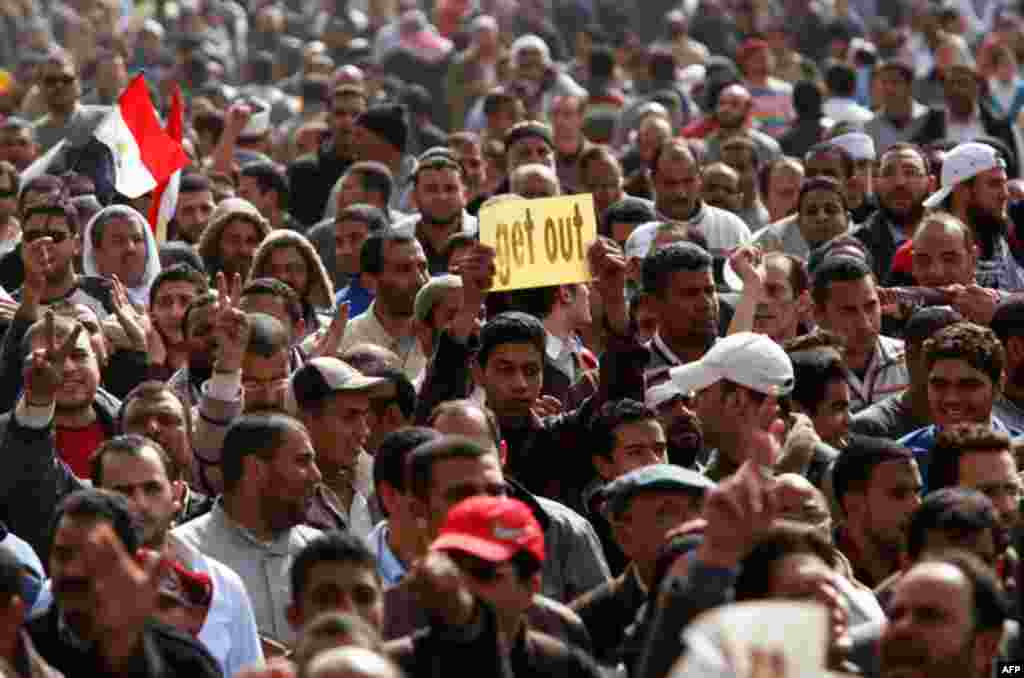 "February 4: Opposition supporters rally after Friday prayers in Tahrir Square in Cairo. Tens of thousands of Egyptians prayed for an immediate end to President Hosni Mubarak's 30-year rule, hoping a million more would join them in what they called the ""Da"