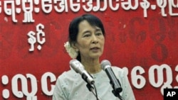 Burma democracy leader Aung San Suu Kyi addresses during a meeting with youth members of her National League for Democracy party at the party's headquarters in Rangoon, Burma, February 8, 2011