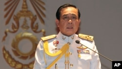 FILE - Gen. Prayuth Chan-ocha speaks at the start of his first press conference since Thursday's coup, May 26, 2014.