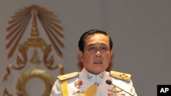 FILE - Gen. Prayuth Chan-ocha speaks at the start of his first press conference since Thursday's coup, May 26 , 2014.
