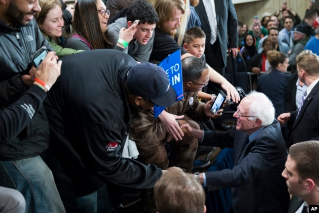 Democratic presidential candidate Sen. Bernie Sanders, I-Vt., shakes hands during a United Auto Workers rally in Dearborn, Michigan, Feb. 16, 2016.