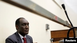 FILE - Exiled Rwandan General Faustin Kayumba Nyamwasa looks on during his court appearance in Johannesburg.