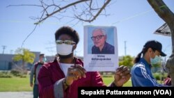 An African-American holding a portrait picture of Vicha Ratanapakdee during the Asian American event to raise awareness about the increase in hate crimes against Asians in the US near Chinatown Los Angeles, CA.