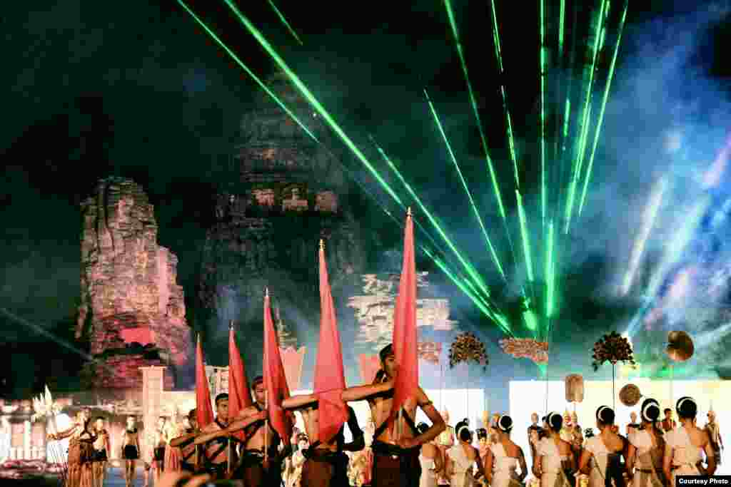 A light and sound show is staged at the ancient Khmer city of Phimai in Nakhon Ratchasima province, as part of an annual festival, Nov. 7, 2014. The event is held within the grounds of a temple at Phimai Historical Park, Thailand, which marks one end of the former Khmer highway from Angkor. (Photo taken by Matthew Richards/Thailand/VOA reader)